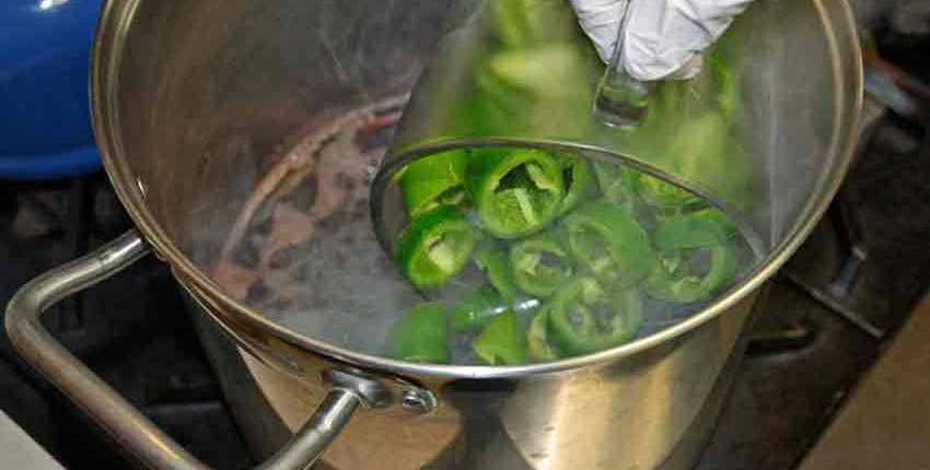Adding jalapeños to hot brine